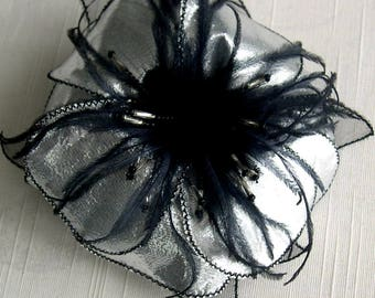 Flower brooch in silver lamé fabric, black feathers and beads