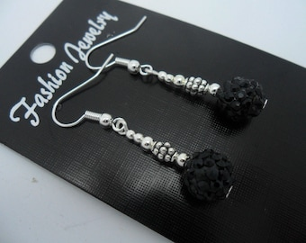 A pair of pretty black shamballa style dangly dangly earrings.