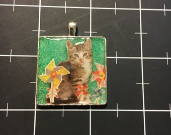 Pinwheel Kitten. 50% of the proceeds goes to the current focus charity