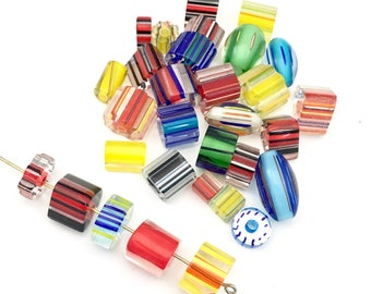 24 furnace glass beads, 6mm to 13mm # PV 009