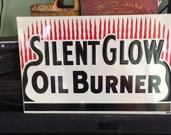 Antique 1954 Advertising Embossed metal SILENT GLOW Oil Burner sign
