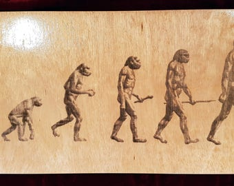 Wooden Poster - Evolution of Man - Engraved on Lauan Wood.
