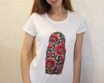 T-shirt with a print of Polkhov Maidan Matrioshka, Nesting dolls.