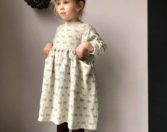 The Pier Dress. 100% linen with vintage inspired print, raglan sleeve and shell button back.