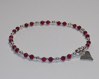 Sterling silver beaded bracelet with garnets and heart charm