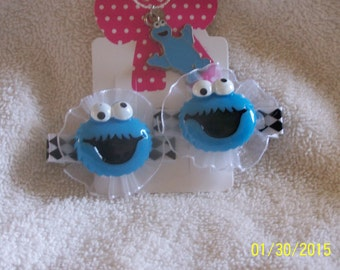 Cookie Monster hair clips and necklace. If your child loves Cookie Monster, they will love this set.