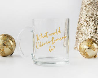"""Law and Order SVU / """"What Would Olivia Benson Do?"""" - Clear Glass 11 fl oz. Coffee Mug with Gold Text"""