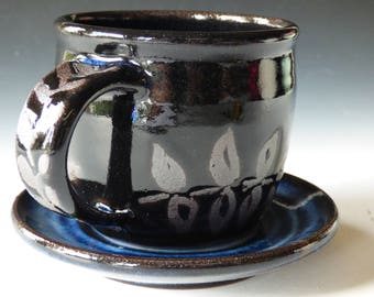 blue/black cup and saucer