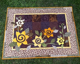 Quilt with sunflowers in handmade applique