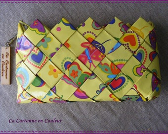 Wallet in recycled paper laminated multicolor on yellow background