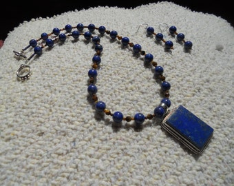 Midnight blue Lapis Lazuli with golden mineral flecks and golden hued Tiger Eye are the perfect balance.