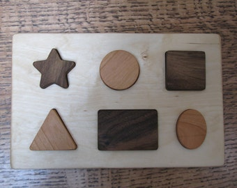 Developmental Shape Puzzle #1, wooden, easy for little hands to grip and learn.