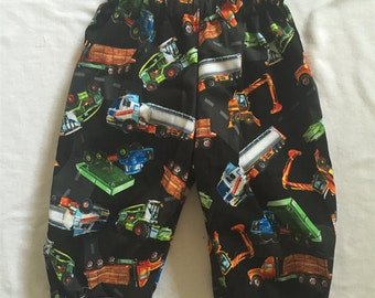 "Handmade Baby Boys Pants in ""Black Trucks' Print 100% Cotton. Size 1"