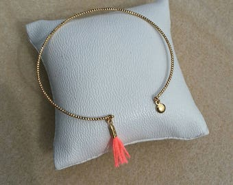 Gold Bangle Bracelet charm and neon coral tassel