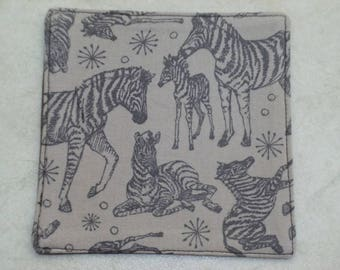 Drinks Coaster.  Tossed Zebras print.  Grey back.  Cotton fabric.  Fully washable.