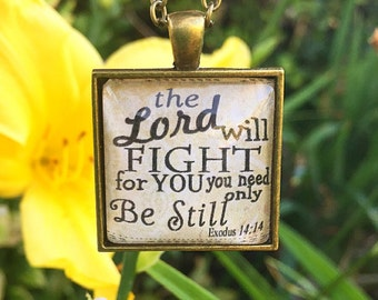 "Bible Verse Pendant Necklace ""The Lord will fight for you you need only be still. Exodus 14:14"""