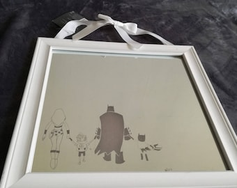 White wood frame mirror 34 x 34 cm - engraving of a family of superheroes