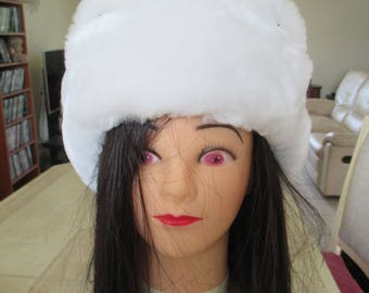 fur hat in white or black faux fur lining