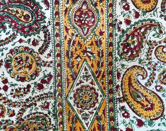 Vintage block print Indian cotton fabric; red and yellow paisley