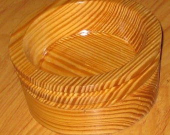 oak bowl made from oak pieces that are turned so there is a different grain on each level