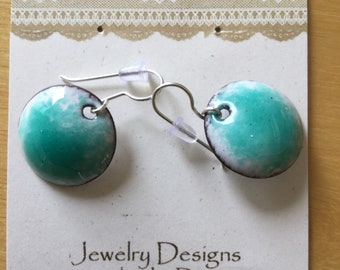 Gem Green Enameled Earrings with white background.