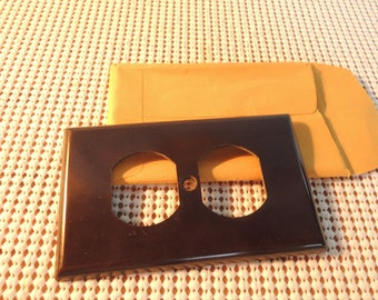 Electrical wall outlet cover, Brown plastic, New old stock, Original bag, Vintage