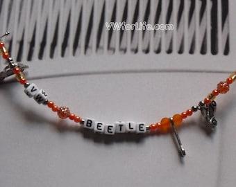 Orange VW Beetle With Spanner Bracelet