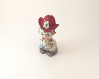 Vintage firefighter figurine. Japan baby collectible.Porcelain fireman figure collectable. Fire chief hat figure with hose. Nursery decor