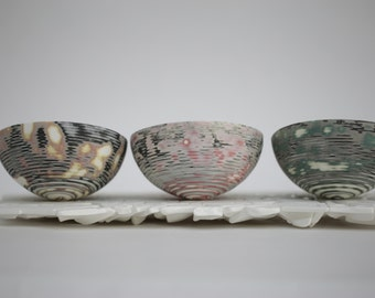 English fine bone china stoneware bowl with a unique patterned surface and unusual shape.