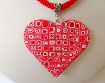 Heart polymer clay pendant on a red kumihimo braid.
