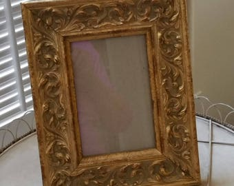 Small table top gilt frame