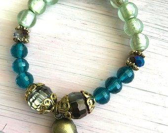 Skull bracelet with crystals and recycled glass beads magic energy