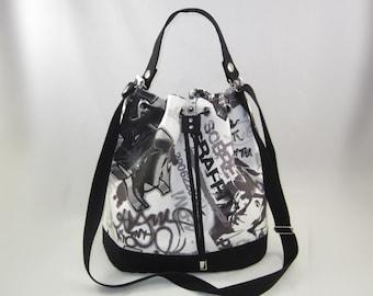 Black and white graffiti bucket bag