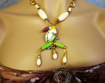 gold necklace: Red beaked toucan.