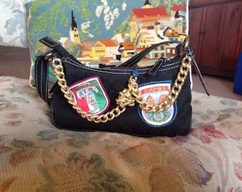 Refashioned small black handbag purse with appliquéd patches and chain