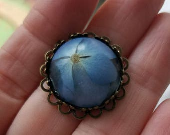 Real blue hydrangea flower pendant in bronze metal setting