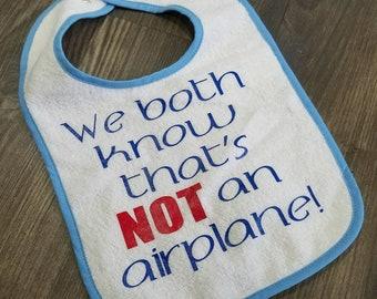 we both know that's not an airplane bib, terry cloth bib