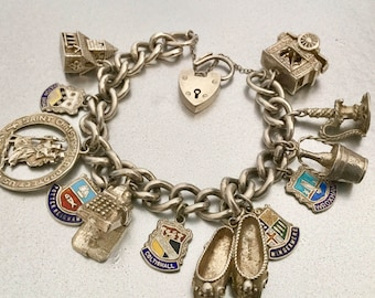 Vintage English Sterling Silver Charm Bracelet. Hallmarked 1960s. Chunky. Mechanical & Coat Of Arms Travel Charms Nuvo Punch Judy Side Show