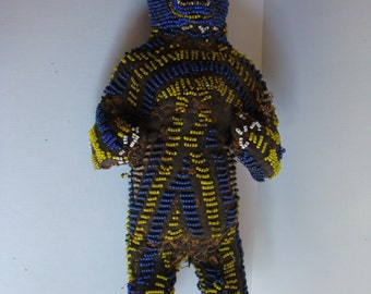 African statuette set with blue and yellow pearls, Bamileke, Cameroon