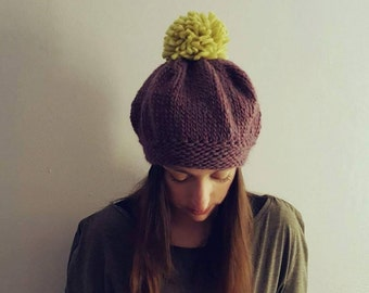 Woolen hat / beret / beanie with pom pom. Hand knitted hat / beret made by 100% virgin wool yarn. Avaiable in many color combinations.