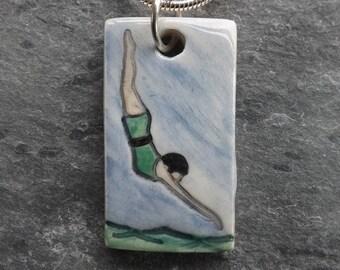 Diving Belle ceramic pendant in green