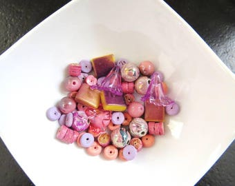 Lot of 50 beads in soft pink and old pink