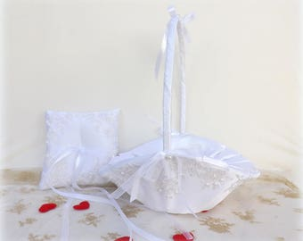 White flower girl basket and a wedding ring pillow set. White embroidered floral lace and white pearls. Wedding decoration.