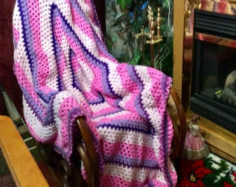 Vintage handmade crocheted pink purple granny square afghan.