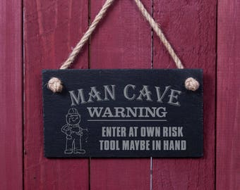 Funny sign: Man cave WARNING (FAD1057)