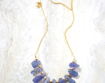 multi rough tanzanite  drop necklace. freeform unpolished tanzanite necklace. gold filled chain. raw tanzanite with gold filled detail