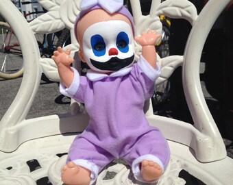 Creepy Clown Baby in purple.
