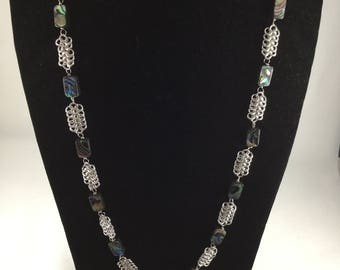 Long Chainmaille European 4 in 1 weave as connectors to rectangle flat abalone beads. Finished with a heart toggle clasp.