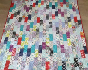 Colorful quilt made with designer fabrics
