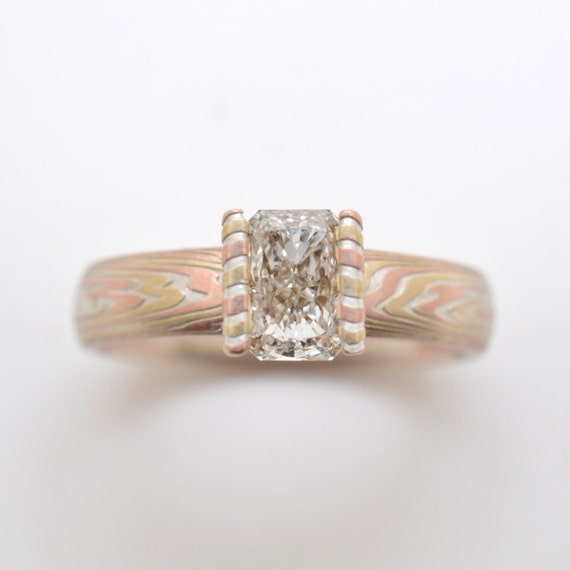 mokume shakudo edges izaak wedding khan sleeve gold rings with rose nz gane design and